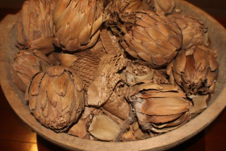 Bowl of carved wooden artichokes in Ohio hotel lobby.